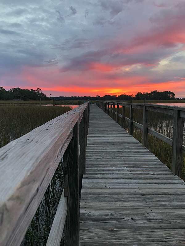 Coastal walkway and sunset