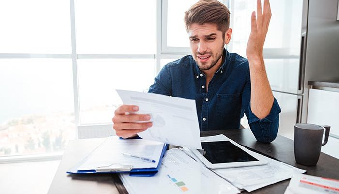 Man frustrated with paperwork