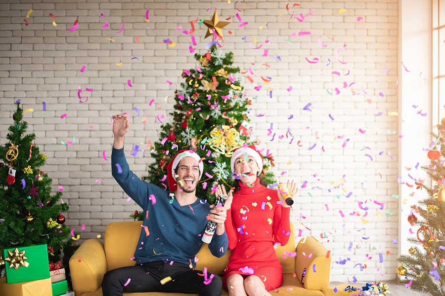 Christmas couple in front of tree