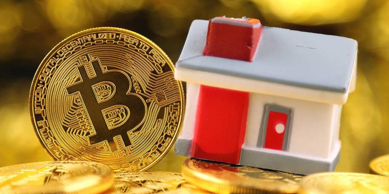 a bitcoin and toy house